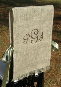 Monogrammed chair covers - maybe in holiday colors!