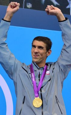 RECORD BREAKER  After giving some underwhelming performances, Michael Phelps scores gold as part of the men's 4x200-meter freestyle relay final and breaks the record for most medals, winning his 19th one.