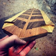 Handmade longboard. I like how in the middle layer of the deck, the shape is cut in such a way that the top and bottom layer sandwich it together for a dope design. Props to the creator.