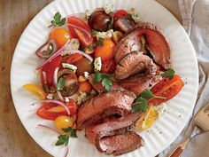 Seared Steak with Tomato and Blue Cheese Salad | Maintaining a healthy weight or trying to lose a few pounds ultimately revolves around the science of counting calories. It's a tedious task to tabulate every morsel you put in your mouth, but there's a simpler and much more flexible strategy: Start a file of skinny recipes. Use this collection of low-calorie dinners as a starting point. As always, taste comes first, so we've pulled together our best recipes that are big on flavor and in step…