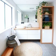 Shelley's bathroom is styled to perfection. Love the timber accents and greenery to soften the space