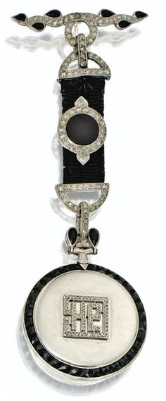 Art Deco platinum, onyx, and diamond pendant-watch by Cartier, circa 1910. Via Sotheby's.