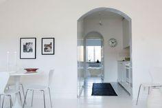 white kitchen under arch, source unknown