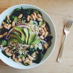 Vegan avocado salad filled with brown rice, cannelini beans, red onion, cucumbers and avocado drizzled with creamy avocado garlic dressing.