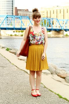 Shop this look on Lookastic:  http://lookastic.com/women/looks/multi-colored-tank-and-tobacco-tote-bag-and-mustard-mini-skirt-and-red-ballerina-shoes/2475  — Multi colored Floral Tank  — Tobacco Leather Tote Bag  — Mustard Pleated Mini Skirt  — Red Leather Ballerina Shoes