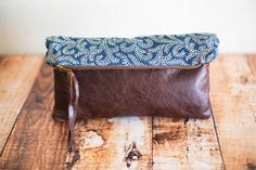 clutch,handmade leather bag,leather purse,foldover clutch,zippered pouch,leather and fabric bag,zipper clutch,bag,purse,handmade purse. $78.00, via Etsy