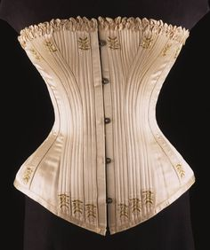 Woman's Corset Artist/maker unknown, American Geography: Made in United States, North and Central America Date: c. 1890 Medium: Ivory silk satin embroidered with silk, baleen (whalebone), metal busk Vintage Corset, Vintage Underwear, Victorian Corset, Vintage Lingerie, Neo Victorian, Victorian Women, 1890s Fashion, Victorian Fashion, Vintage Fashion