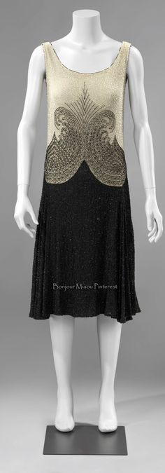 Evening dress, French, ca. 1927–28. Ecru cotton bodice and black cotton skirt, all covered with glass beads. Rijksmuseum