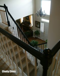 foyer with black bannister