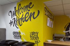 In this post you'll see hand lettered wall painting of Victoria and Vitalina. Wall murals are modern form of art which Restaurant Interior Design, Office Interior Design, Office Interiors, Office Mural, Office Walls, Fast Food Design, Office Wall Graphics, Mural Wall Art, Garage Design