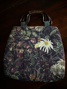 Fun purse with whimsical leather flower embellishment ;)