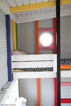Loving this children's cubby house; the neutral with splashes of colour