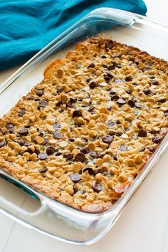 5 ingredient Chocolate Peanut Butter Magic Bars! Rich and fudgy one pan dessert with sweetened condensed milk and a graham cracker crust. I used to make these with my gramma all the time!! They are good with butterscotch or Carmel chips too!!