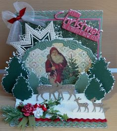 Card made by DT member Astrid with among others Craftables Merry Christmas (CR1327), Anja's Flower Border (CR1330), Creatables Star XL (LR0369), Pinetree Set (LR0370) and Oval Pop-up (LR0371) by Marianne Design