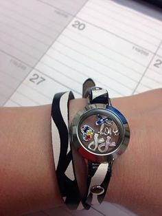 Zebra print leather wrap bracelet from #OrigamiOwl.  The #charms represent #autismawarenessmonth and the ribbons are in memory and in honor of those affected by #cancer in my family.   Please visit my #designer page: http://rschaffold.origamiowl.com