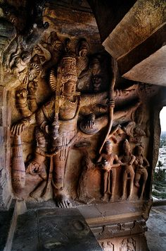 Badami - Vishnu takes large steps to stride over the universe. This is a sculpted panel from Badami caves.  Cave 3 is supposed to have been made in the 6th century and is dedicated to various incarnations of Vishnu, the Hindu God.