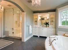 Wow, I WISH I had this much room for a bathroom...  Nice shower & tub. Sink is too small but the cabinet is gorgeous...  Would change that to have a table to do makeup and add a nice sized sink on another wall.... Sigh...