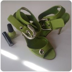 """LIME GREEN MANOLO BLAHNIK HEELS IN BOX Eye catching 4"""" heel lime green satin finish heels with large silver ankle buckle!  The bottom of the shoes show very little wear & the leather is in excellent condition. There are a few rubs on some areas of the fabric but nothing more than what is shown in the photo of the heels!  These are sized 38 or 7.5 but run more like a 7. Im a true 7 and they fit me well but because there is no platform, it causes too much stress to my foot. These come with box…"""