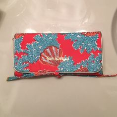 Lilly Pulitzer Makeup/Brush Pouch Pre-owned LP brush pouch. No exterior stains or scratches just two tiny dots on the inside. Perfect for traveling or daily storage. Vibrant color. Lilly Pulitzer Bags Cosmetic Bags & Cases