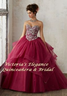 Glamorous organza Quinceañera dress with delicately beaded cascading tiered skirt. Sweetheart neckline bodice features intricate jewel beading and corset back. Matching bolero jacket includedEstimated Shipping: 20 weeks