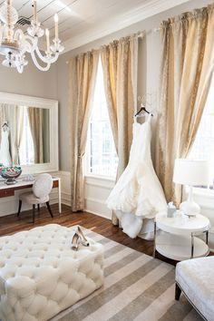 wedding dress hanging in grand room. <>£I so need a picture like this