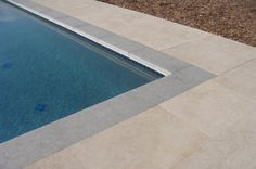 Aegean Limestone Square Edge Eased Pool Coping - Flamed Finish & Fiore Gold Limestone Paving - Shagreen Finish