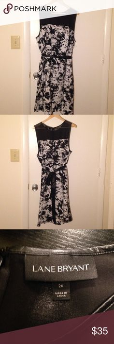 Lane Bryant - Black and White Floral Dress A black and white floral print dress by Lane Bryant. Only worn once. Runs a little small for the size. This 26 seemed equivalent to a 24. Comes with a black ribbon belt. Zipper in back. Lane Bryant Dresses Midi