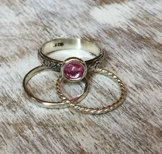 Set of 3 Sterling Silver stacking rings: 1 Hammered, 1 Twisted, and 1 with a pretty cabochon in your choice of stones. Stones are 5mm Cabochons in Blue Topaz, Peridot, lab grown Pink Sapphire, Amethyst and Moonstone.  Handmade Artisan Jewelry available at www.lalabliss.com