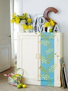 Fun use of letters... love the dresser design and color palette