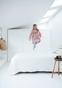 """Dwell """"Hygge House"""" vedbaek house, Denmark. Bright guest room with skylights and happy little girl!"""
