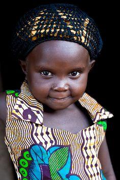 Africa | Lendu child on the doorstep oh her mud hut. Gety village. Ituri district  |  © Christophe Stramba-Badiali