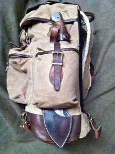 L.L.Bean Waxed Cotton Continental Rucksack http://www.llbean.com/llb/shop/54122?feat=rucksack-SR0&page=waxed-cotton-continental-rucksack&attrValue_0=Khaki&productId=909928&qs=3077620