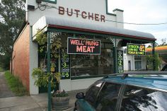 Seville butcher advertising his wares! Or himself perhaps?   Funny - Hilarious Signs & Billboards