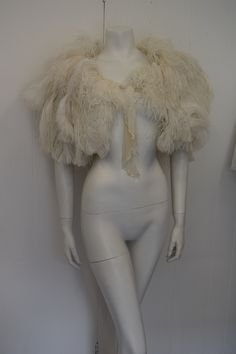 Stunningly beautiful Ostrich Feather Cape from the 1920s, perfect one off piece for all occasions and weddings or for the bride! looks beautiful draped over any garment. The structure is amazing and the use of individual feathers has a certain flow and artistic structure to it, a piece of history to wear and keep for years to come..... Approx size UK 8,10,12,14,16 depending on how you wear it. The cape has a front tie fastening that can be adjusted to size. Length of cape: ...