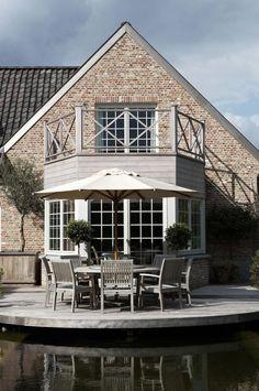 Stunning window looking over this gorgeous terrace area | Mi Casa - Campagnard | Govaert-Lagae