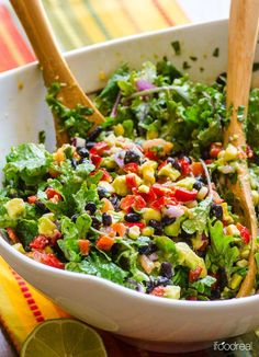 Creamy Mexican Kale Salad Recipe made with black beans, corn, peppers, tomato, cilantro and tossed with a tangy cumin flavoured avocado dressing.   ifoodreal.com #mexicanfoodrecipes