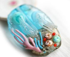 Hey, I found this really awesome Etsy listing at http://www.etsy.com/listing/176192692/jellyfish-glass-lampwork-bead-ocean-aqua