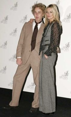 Kate Moss in tweed pants + waistcoat and bow tie blouse