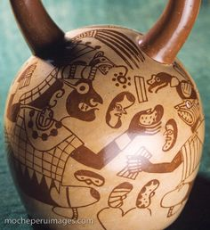 Photograph of a Moche (Mochica) ceramic pot vessel decorated with fineline drawing depicting anthropomorphic beans being exchanged between priests or other high rank officials. Moche believed beans had mystical power or magic, and often appear in Mochica art decoration.