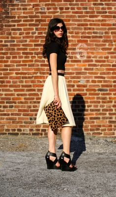 Eden wearing her Love,Cortnie 'Ashleigh' clutch with black and white. Perfect pop of leopard.   via Garden of Glam
