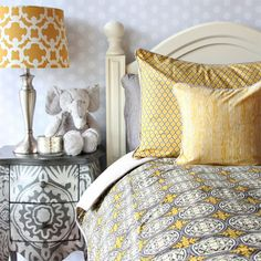 The Buckley Bedding Collection has a vintage gray duvet which gives a modern vibe to a traditional design. The yellow and gray colors are great for any big kid room. The vintage gray bedding features shades of gray with a fun wood grain print and the decorative pillow sham has a Moroccan lattice print.