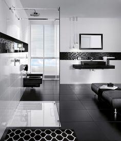 salle de bain moderne en noir et blanc avec un carrelage de sol noir mat et mosaïque noire brillante