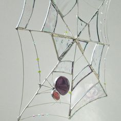 Purple Spider in a Spider Web Stained Glass and Wire Suncatcher ~ by FiveSparrows, via Etsy.