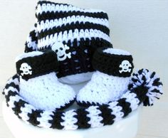 Crocheted baby pixie hat and booties black and white skull Halloween set.. $34.00, via Etsy.