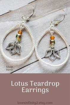 These gorgeous Lotus flower teardrop earrings will be the perfect accessory for the upcoming fall season. Made with Silver teardrop dangles, fall colored crystals, and lotus flower charm
