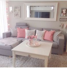 Pink and zigzag cushions to complement the nice grey room.