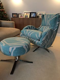 Turquoise Swirl Fabric On Our Contemporary Designer Swivel And Tilt Chair  With Matching Footstool.