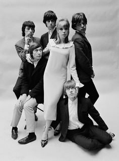 The Rolling Stones borrow Pattie Boyd for a photo session with John French, April 1964.