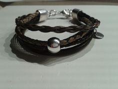 #Armband. Eine Kombination von Lederbändern und geflochtenem #Pferdehaar.
