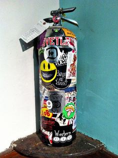 One of The Chelsea Hotel's old, grungy, graffiti/collage/decoupage-embellished fire extinguishers